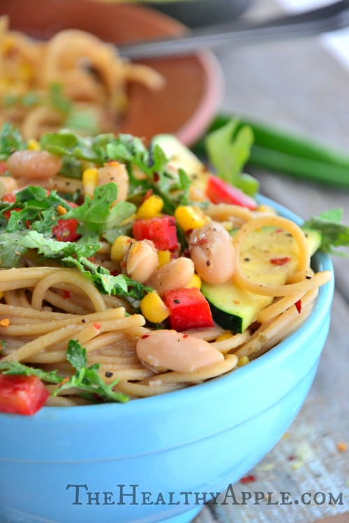A close-up of the bowl of pasta stuffed with veggies and beans.