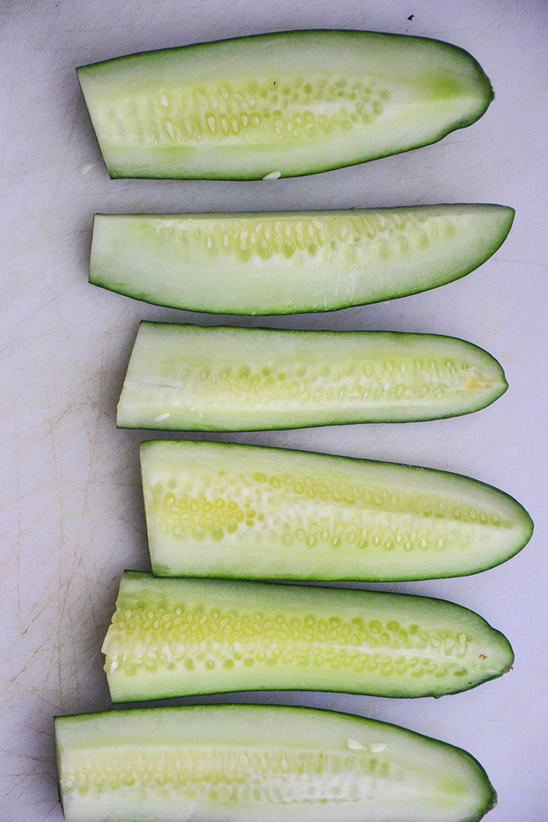 Quartered cucumbers placed in a line.