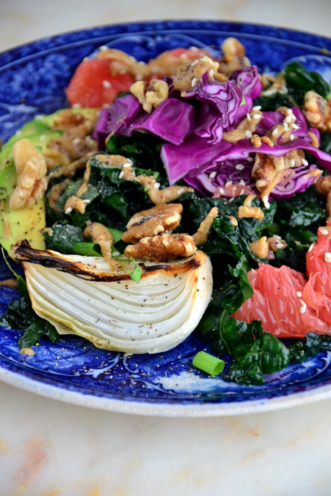 Roasted sweet onions with massaged kale avocado salad drizzled with a creamy almond dressing for a quick lunch or dinner!
