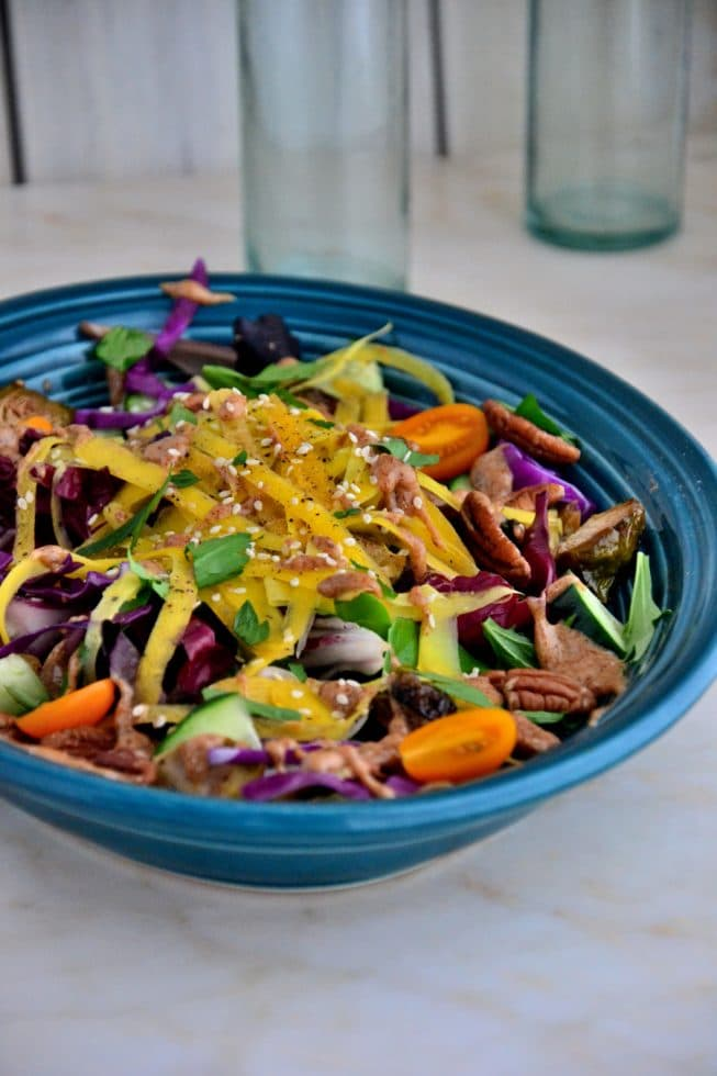 This Brussel Sprout Salad is delicious when served chilled or at room temperature; it's tossed with yellow carrots, cherry tomatoes,cucumbers, salad greens and pecans!
