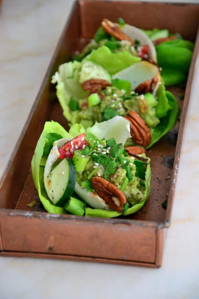 Gorgeous Vegetarian Lettuce Wraps filled with guacamole, fresh veggies, herbs and more on a beautiful platter!