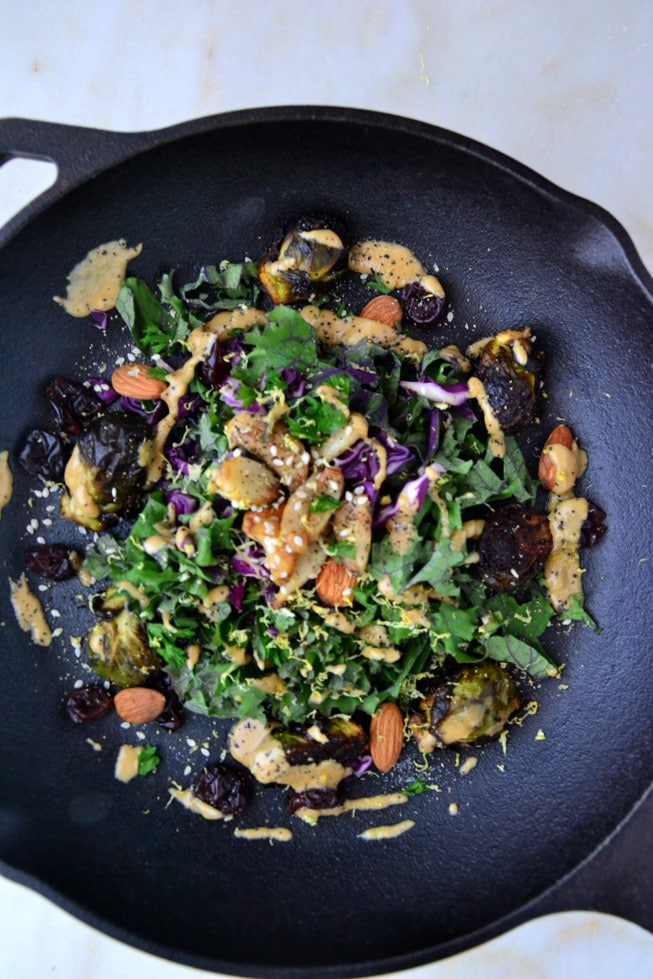 This Roasted Brussels Sprouts with Balsamic Glaze is easy to make for dinner and is loaded with detoxifying veggies and a balsamic dressing in a beautiful cast iron skillet.