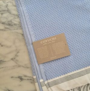 These organic Coyuchi towels are so incredibly soft and beautiful; they're a gorgeous blue and they're shown here laid out over a marble table. The best organic duvet covers are one of Coyuchi's best signature pieces.