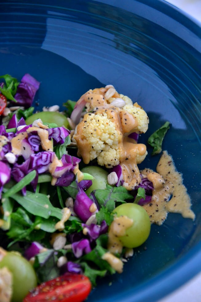 This Detox Salad with Kale is loaded with roasted cauliflower, tomatoes, grapes and other detoxifying veggies.