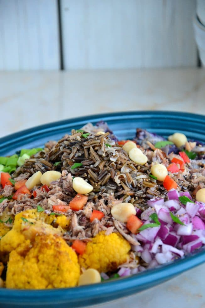 Warm Roasted Cauliflower and Wild Rice Platter on a blue platter with Red Bell Pepper and more!