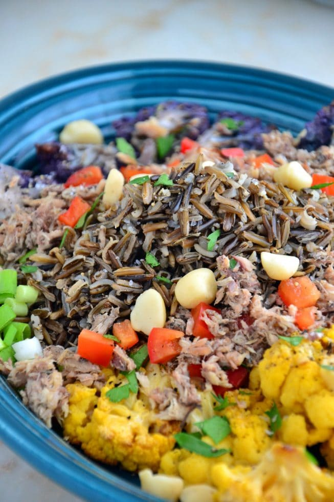 Easy Roasted Cauliflower and Wild Rice Platter Recipe in Blue Salad Bowl with Macadamia Nuts