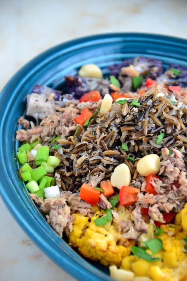 30 Minute Roasted Cauliflower and Wild Rice Platter in a blue bowl with Sardines and More!