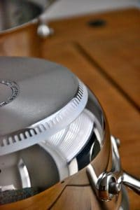 Stainless steel Lagostina cookware set on a wooden table.