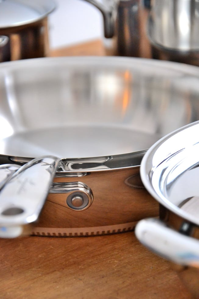 Gorgeous Lagostina cookware set on a wooden table.