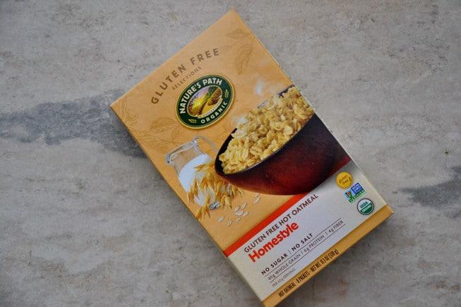 Nature's Path gluten-free oatmeal on a beautiful marble slate.