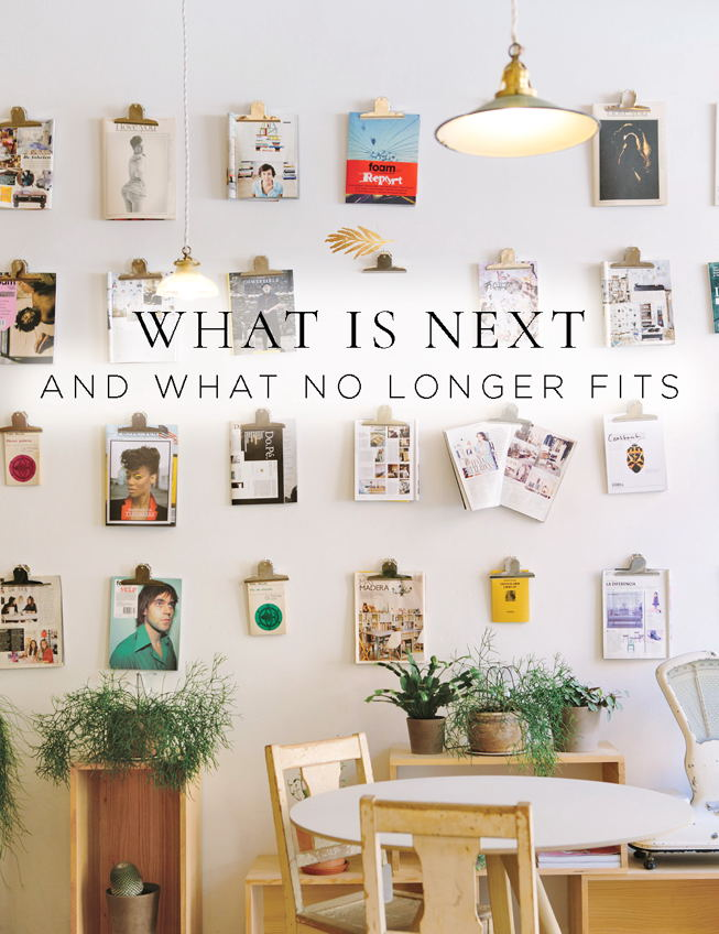 What is next and what no longer fits room filled with beautiful photos on the walls and a wooden table.