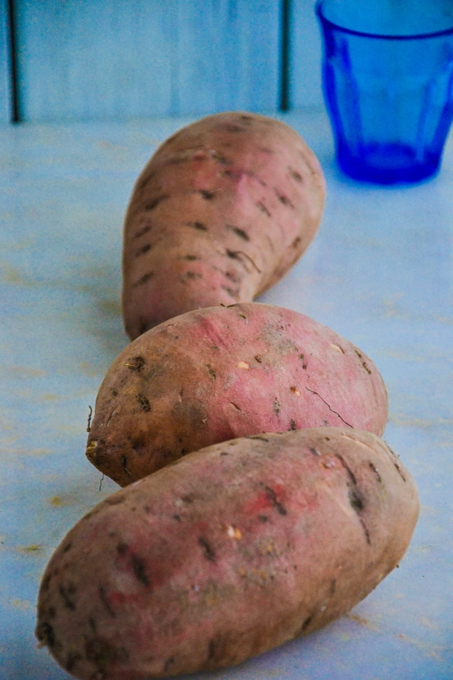 Healthy Oven Roasted Sweet Potatoes recipe starts with raw sweet potatoes before they go in the oven.