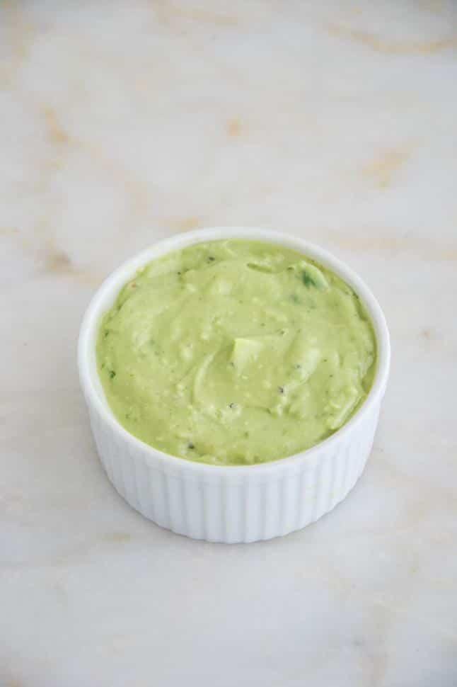 Fajita Lettuce Wraps with avocado sauce in a white bowl.