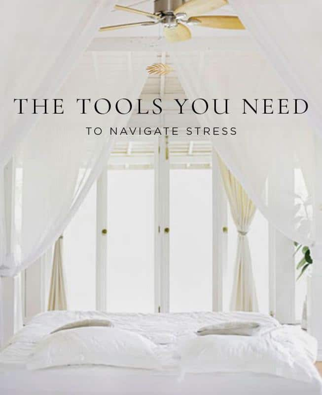 Beautiful white bedroom and the tools you need to navigate stress.