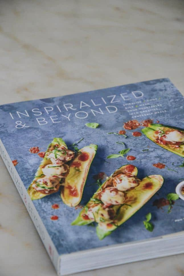 Inspiralized and Beyond cookbook on a marble table top.