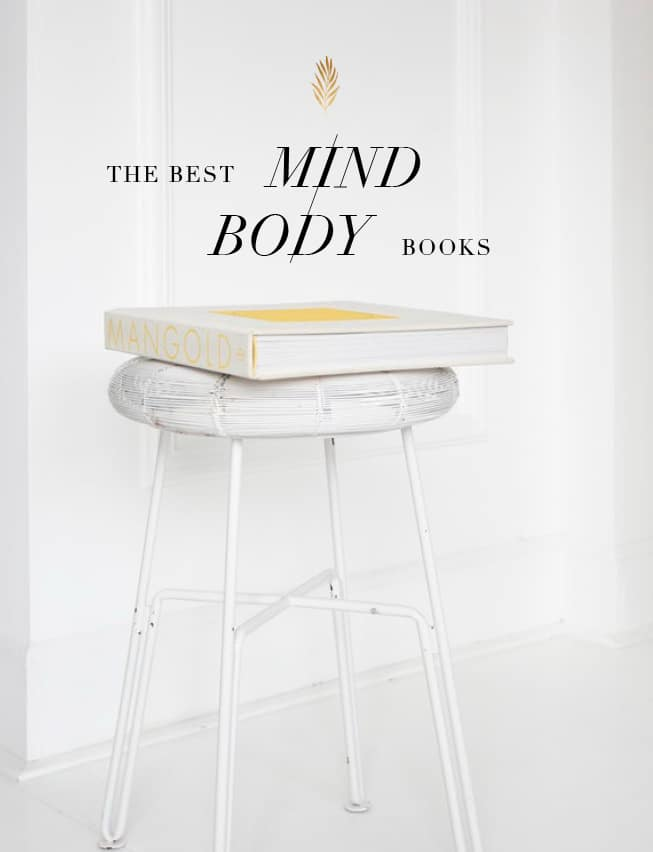 the best mind body books on a stool in a white room