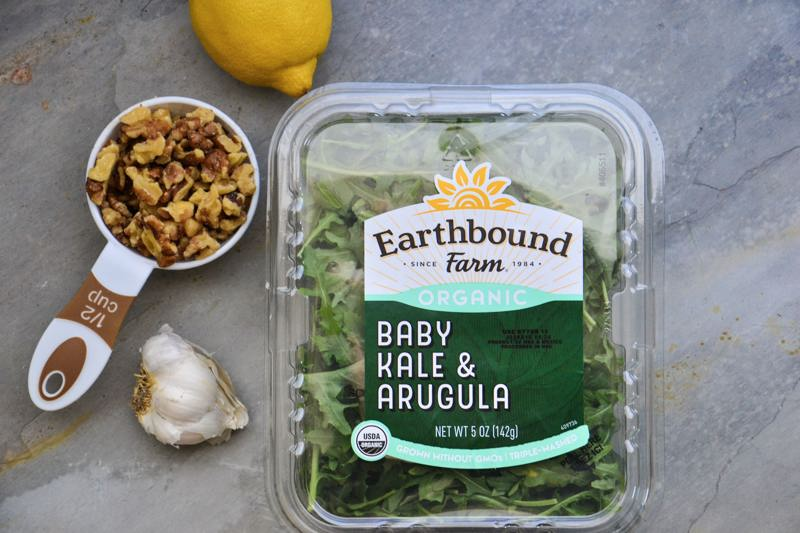 A package of Earthbound farm organic baby kale & arugula mix.