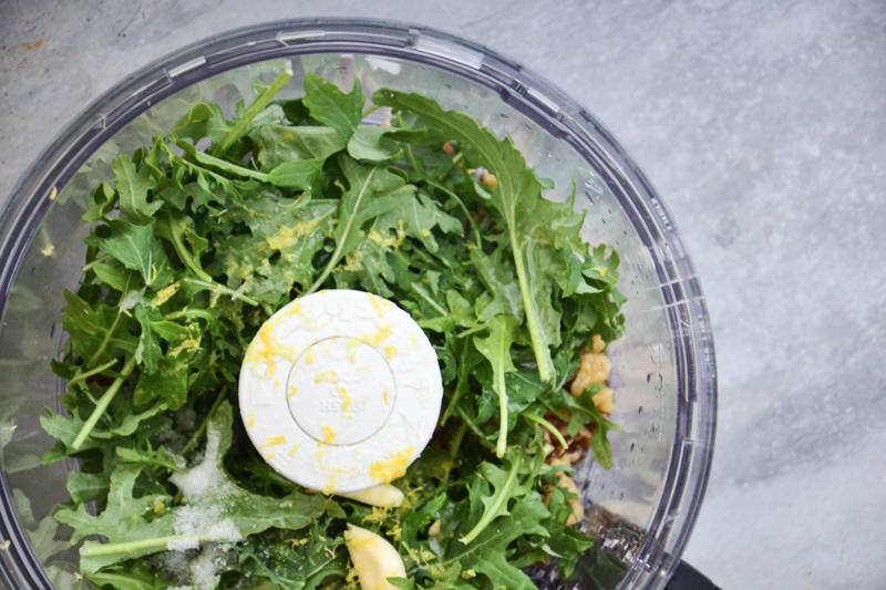Earthbound Farm organic arugula & kale mix in a food processor.