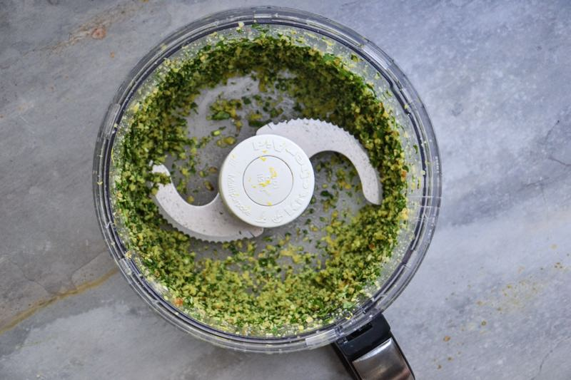 Gluten-free, vegan arugula pesto just blended in a food processor.
