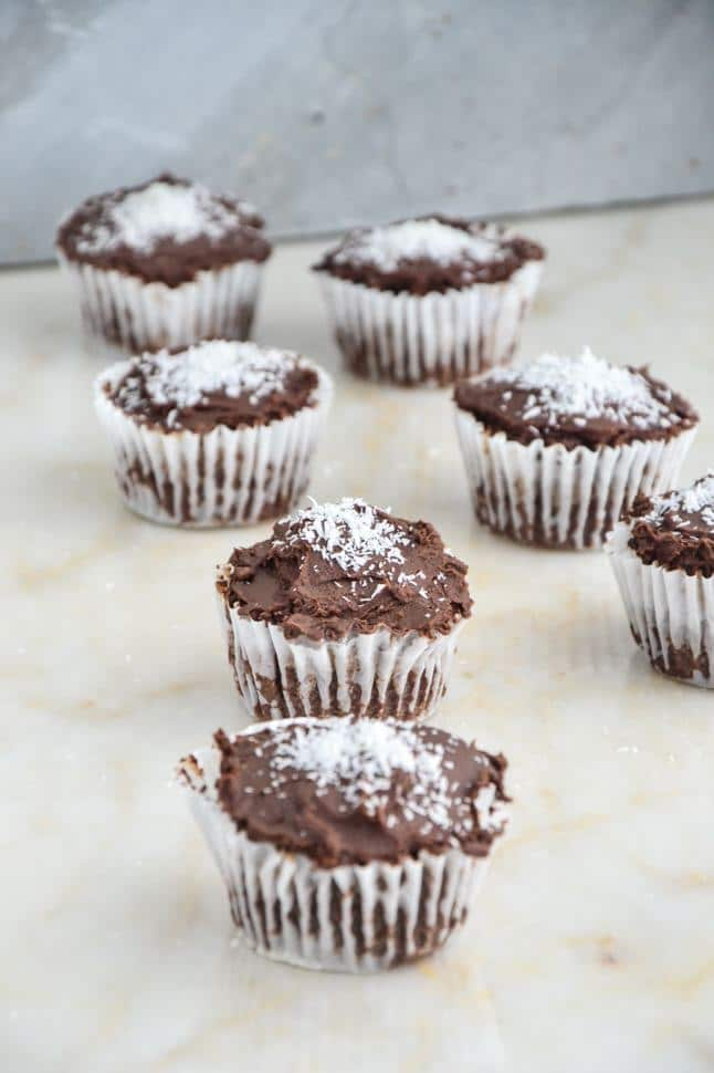 Gluten free chocolate cupcakes with coconut on top.