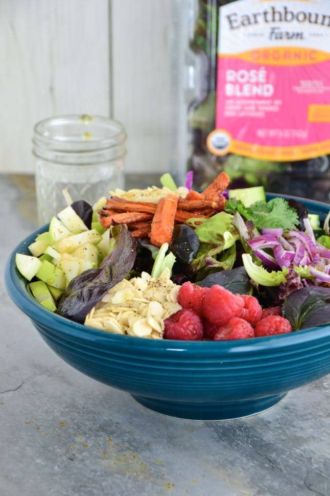 A huge bowl full of all of the salad ingredients combined and bunched ready to eat.