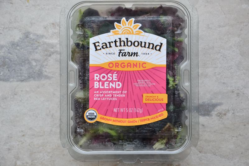 A package of Earthbound Farm Rose Blend salad.