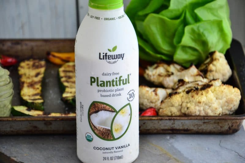 Lifeway Kefir probiotic plant based drink next to a baking sheet full of roasted vegetables