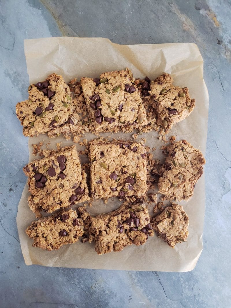 A pan of pumpkin seed bars cut into nine even squares.